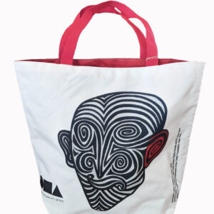 White tote bag with black and white face, red handles